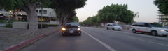 Rear view of a Driving Plate: Car travels on Hope Street in Los Angeles at Stock Footage