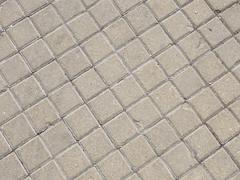Old gray paving slabs Stock Photos