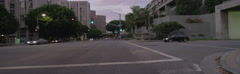 Front view of a Driving Plate: Car turns right from Figueroa Street in Los Stock Footage
