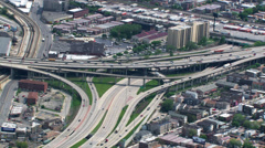 Zoom-out from overhead view of freeway interchange to Chicago skyline. Shot in Stock Footage