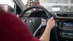 Business Woman in a new Car Nissan hold the Wheel gently Stock Footage