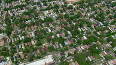 Slow, high flight over Chicago suburban area. Shot in 2003. - stock footage