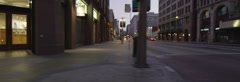 Left Side view of a Driving Plate: Car turns left from 3rd Street onto Broadway Stock Footage