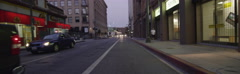 Rear view of a Driving Plate: Car turns left from 3rd Street onto Broadway in Stock Footage