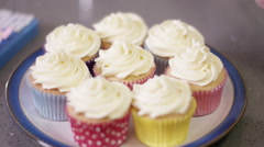 4K Close up of hand sprinkling topping onto fresh cupcakes - stock footage