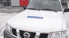 The car of the monitoring mission of the OSCE - snowy winter, Donbass Ukraine Stock Footage