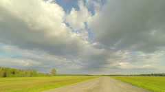 Clouds over the road. The path from Ushakova village, Tyumen region, Russia Stock Footage