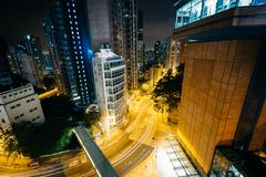 View of skyscrapers and Pok Fu Lam Road at night, from Hong Kong University,  - stock photo