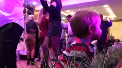 Child and dancing people - stock footage