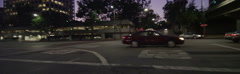Rear view of a Driving Plate: Car travels on 4th Street in Los Angeles at Stock Footage