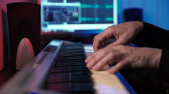 Hands of Musician Playing Keyboard in Dark Studio Stock Footage