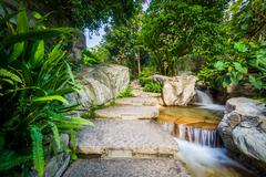 Steps and small cascading waterfall at Cheung Kong Park, Hong Kong, Hong Kong - stock photo