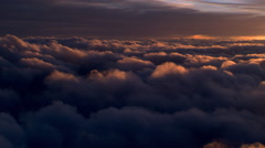 Flying alongside sea of murky clouds, passenger POV Stock Footage