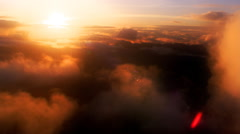 Flight through colorful sunset clouds, close-up passenger POV Stock Footage