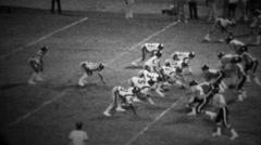 1978: High school football night game quarterback keeps ball. Stock Footage