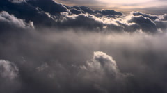 Flying alongside dense gray evening clouds, passenger POV Stock Footage