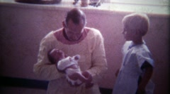 1978: Proud father holds up new baby girl. Stock Footage