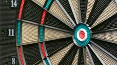 Three Darts Hitting the Double Bullseye Stock Footage