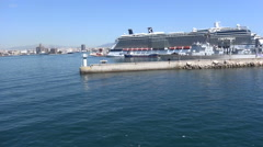 Entrance of Port of Piraeus with an Anchored Cruise Ship - stock footage