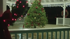 Wide shot man and woman admiring Christmas tree proposal Stock Footage