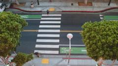 Woman crossing on zebra walk seen from above in Los Angeles - stock footage