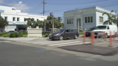 Right Front three Quarter view of a Driving Plate: Car travels on Main Street in Stock Footage