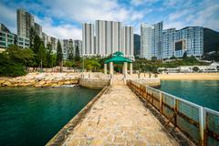 Pier and skyscrapers at Repulse Bay, in Hong Kong, Hong Kong. - stock photo