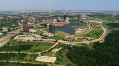 Flying over Las Colinas in Irving, a suburb of Dallas, Texas - stock footage