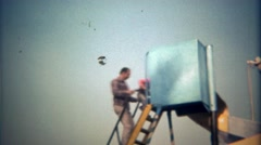 1979: Father and son go down twisted metal slide together. Stock Footage
