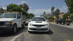 Rear view of a Driving Plate: Car traveling on Ocean Park Boulevard in Santa Stock Footage