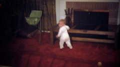 1979: Baby gets upset folds in half to protest living conditions. - stock footage
