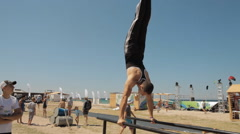 Man is Wrung Doing Handstand on The Parallel bars Stock Footage