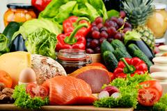 Variety of organic food including vegetables fruit bread dairy and meat. Bala - stock photo