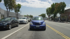 Rear view of a Driving Plate: Car traveling on Lincoln Boulevard in Santa Stock Footage