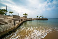 Beach and pier at Repulse Bay, in Hong Kong, Hong Kong. Stock Photos
