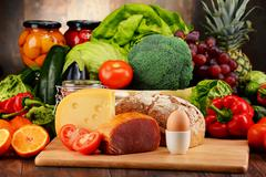 Variety of organic food including vegetables fruit bread dairy and meat. Bala Stock Photos