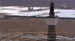 Close flight past solar power tower Stock Footage
