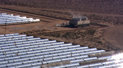 Flying over heat-collecting parabolic solar troughs Stock Footage