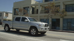 Left Rear Three Quarter view of a Driving Plate: Car traveling on Pico Boulevard Stock Footage