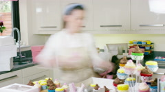 4K Timelapse of busy women in home bakery business packing cakes in boxes Stock Footage
