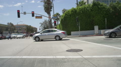 Front view of a Driving Plate: Car traveling on Pico Boulevard in Santa Monica, Stock Footage
