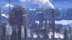 Slow flight past factory smokestacks Stock Footage