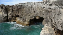 Atlantic ocean waves carve caves into cliff rocks, Devils Mouth, Portugal - stock footage