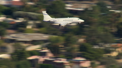 Air-to-air view of executive jet landing Stock Footage