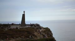 Tourists walk around Cape Roca cross, westernmost point Europe, Portugal - stock footage