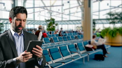 4K Business Man in Airport Terminal Waiting Area Uses iPad Tablet Computer Stock Footage