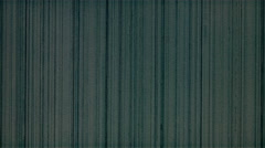 Scratches appearing as evenly spaced stripes on gray motion picture film Stock Footage