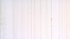 Scratches from projector damage on white motion picture film Stock Footage