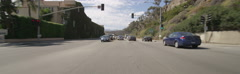 Front view of a Driving Plate: Car travels on Highway 1 from California Incline Stock Footage