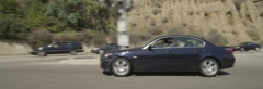 Right Side view of a Driving Plate: Car travels on Highway 1 from California Stock Footage